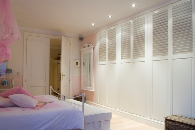 Shutters as cupboard doors bedroom white raised panel