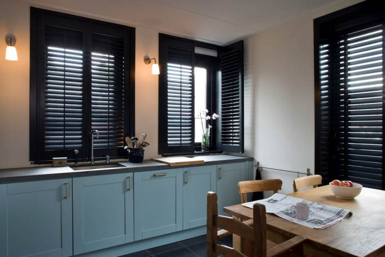 Bring life to the kitchen with shutters and wooden blinds