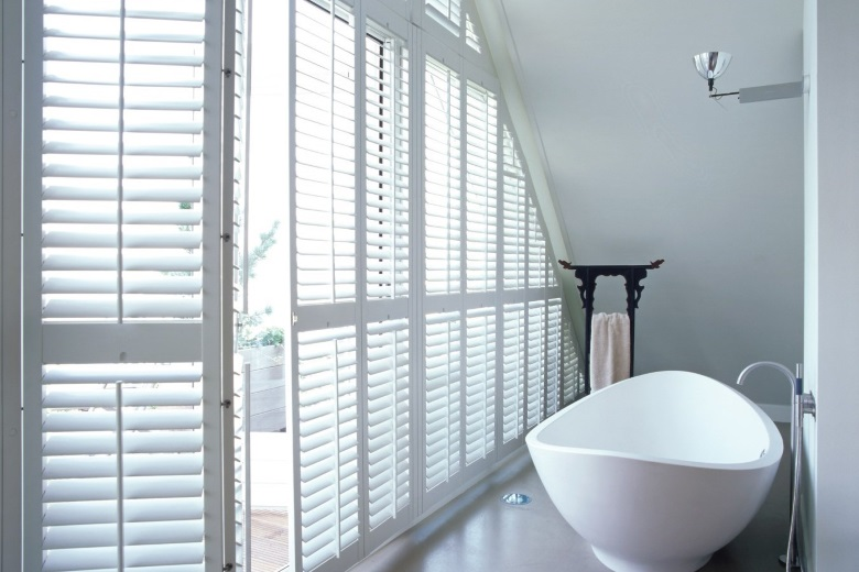 white wooden shutters bathroom without center tiltrod silentview