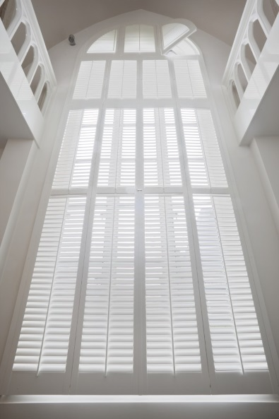 White shutters with round top 6 meters high