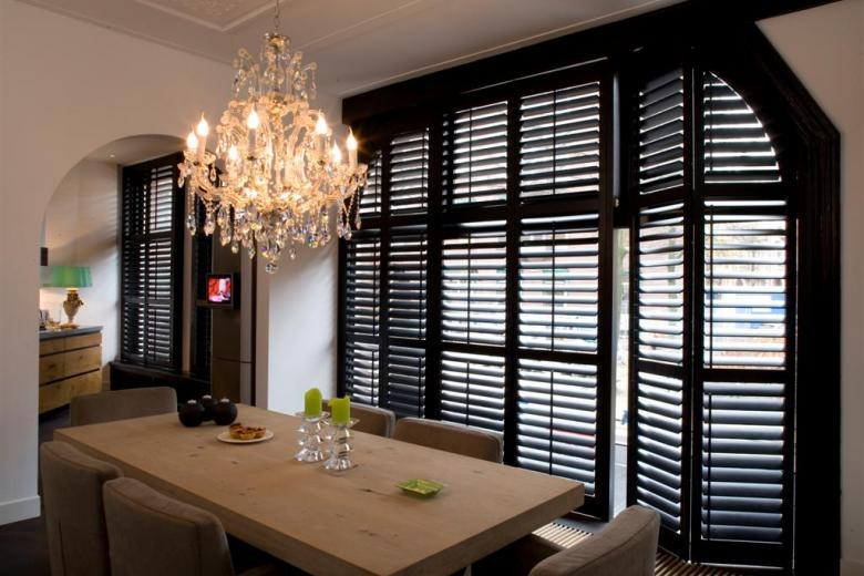 Black shutters in the dining room